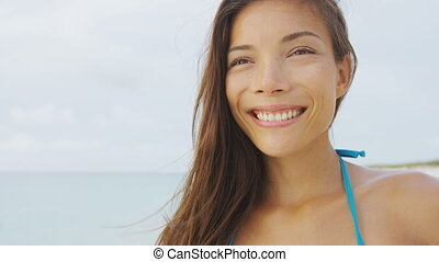 Happy healthy bikini girl smiling on summer holiday beach ...