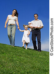 happy healthy family walking, outdoors in summer