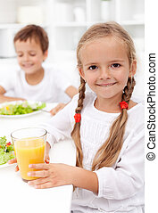 Happy healthy kids eating fresh food - closeup
