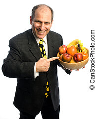 happy healthy man with bowl of fruit