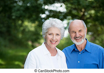 Happy healthy senior couple enjoying a day outdoors in the ...