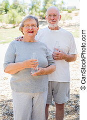 Happy Healthy Senior Couple with Water Bottles