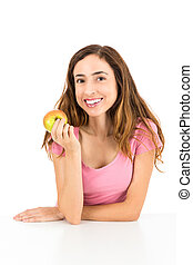 Happy healthy woman eating an apple
