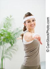 Happy healthy woman making gymnastics