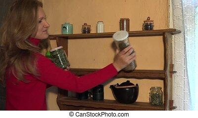 Happy herbalist girl prepare dried healthy herbs for winter. 4K