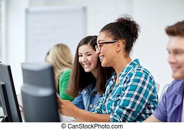 happy high school students in computer class