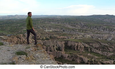 Happy Hiker man Enjoy on the Top of Mountain in Cappadocia, Turkey
