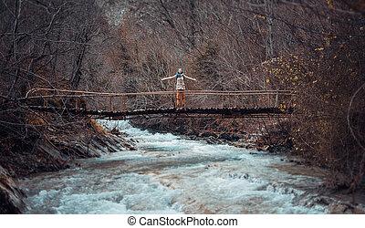 Happy hiker on bridge