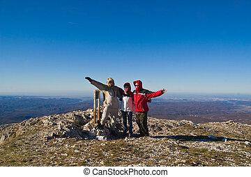 Happy hikers on mount summit