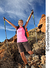 Happy hiking success - Happy woman hiker holding her arms in...