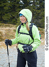 Happy hiking woman in mountains