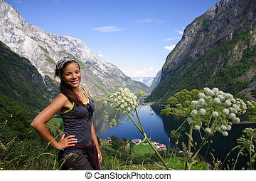 happy hiking - Young woman hiker, Sognefjorden, Norway