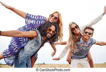 happy hippie friends having fun on cereal field