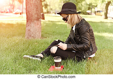 girl sitting with tablet in hand