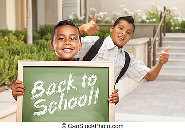Boys Giving Thumbs Up Holding Back to School Chalk Board