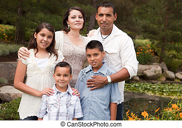 Happy Hispanic Family In the Park - Happy Hispanic Family...