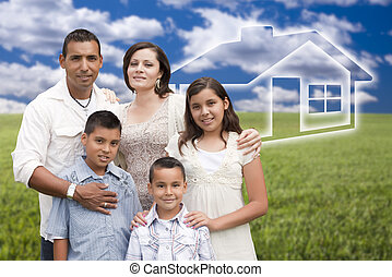 Happy Hispanic Family Standing in Grass Field with Ghosted House Behind.