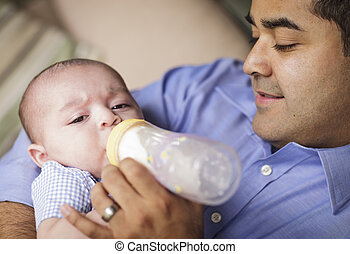 Happy Hispanic Father Bottle Feeding His Son