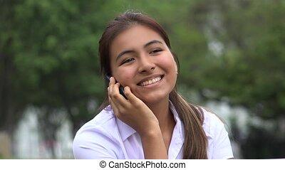 Happy Hispanic Female Teen Cellphone Call