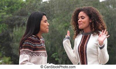 Happy Hispanic Girls Hugging
