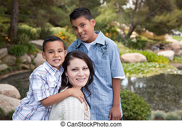 Happy Hispanic Mother and Sons