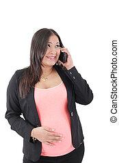 Happy hispanic pregnant woman talks at cell phone