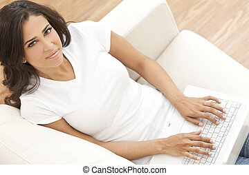 Happy Hispanic Woman Using Laptop Computer
