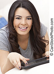 Happy Hispanic Woman Using Tablet Computer or iPad