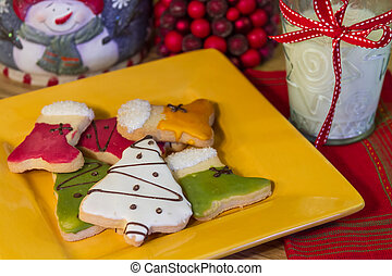 Happy Holiday Cookies - Yellow plate of frosted Christmas...
