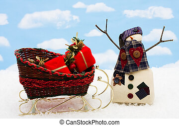 Happy Holidays - A snowman with presents in a sleigh on snow...