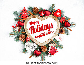 Happy Holidays and happy 2019 text with Holiday Evergreen Branches, frame in the shape of a heart