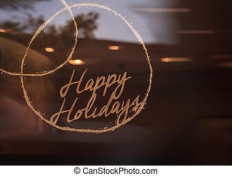 Happy Holidays sign glows