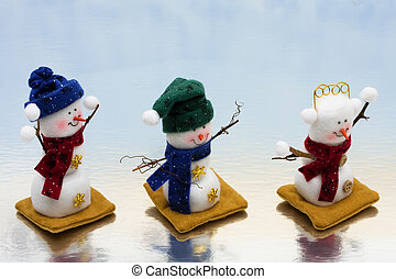 Three snowman sitting together on a icy background, happy holidays