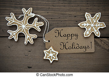 Happy Holidays Tag with some Ginger Bread Cookies with white Decoration on Wood