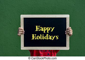 Happy Holidays written blackboard by a children