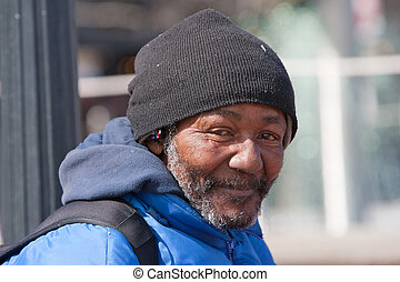 Happy homeless african american man