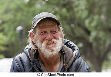 Happy homeless man smiling