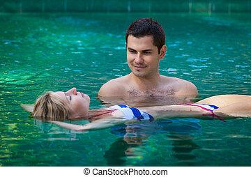 Happy honeymoon in a swimming pool