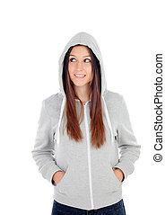 Happy hooded girl with grey sweatshirt looking at side