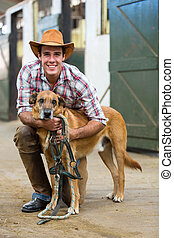 horse farm owner and his dog - happy horse farm owner and...