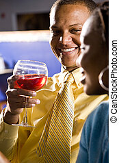 Happy hour - Close up of happy African couple drinking