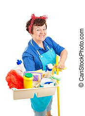 Cheerful cleaning lady holding her tray of cleaning tools and products. Isolated on white.