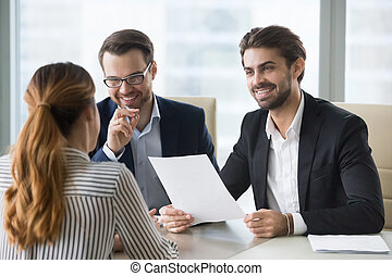 Happy hr manager with resume looking at female job seeker.