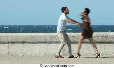 happy hug between husband and wife - euphoric young couple...