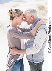 Happy hugging couple on the beach l