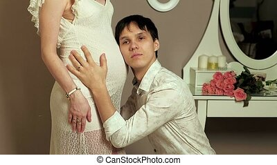 happy husband and wife waiting for baby