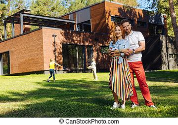 Happy husband hugging his wife