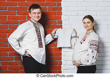 Happy husband with pregnant wife playing