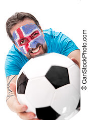 happy icelandic soccer fan with a football