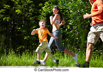 Happy in motion - Happy running family proving the...